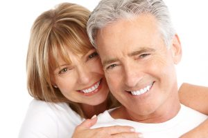 Smiling couple with Cerec one visit crowns