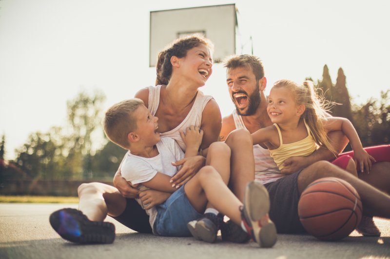 family playing basketball during summer